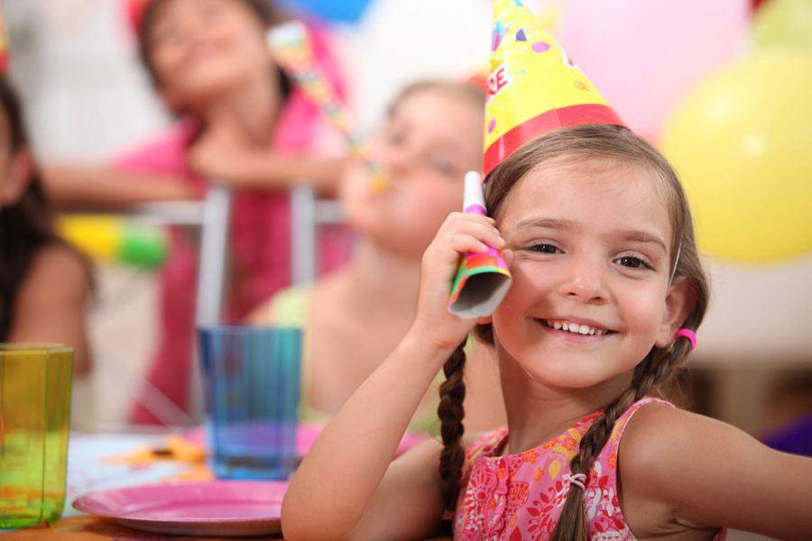 Happy girl at birthday party